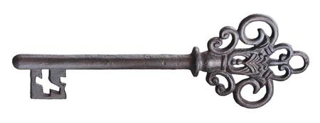 Old rusty door key isolated on white. Stock Photo