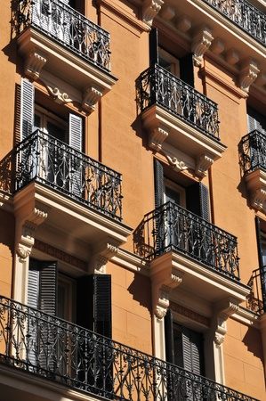 Tipical windows with metal balcony in the city of Madrid (Spain). Stock Photo - 10405455