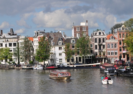 gabled house: Houses and canal in Amsterdam at summer.