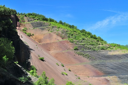 stratification: The internal structure of the volcanic cone exposed due to mining operations - Garrotxa, Catalonia, Spain. Stock Photo