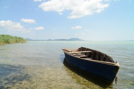 Lake Balaton with old rowing boat (Hungary). Focus on ship nose. Stock Photo