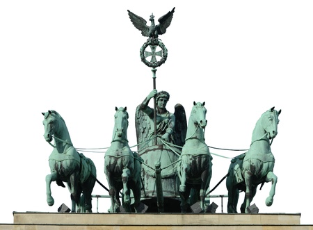 The quadriga - chariot pulled by four horses - on top of the Brandenburg Gate in Berlin (Germany), isolated on white. Quadrigas were emblems of triumph, Victory and Fame often are depicted as the triumphant woman driving the chariot.