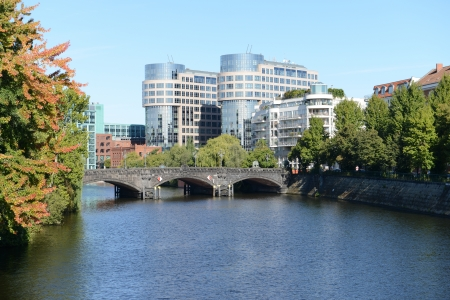 Moabiter Bridge with Federal Ministry of Interior from river Spree in Berlin (Germany).