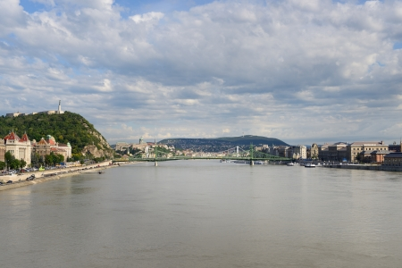 Liberty Bridge between Gellert hill and Pest from river the Danube. Budapest - Hungary  photo