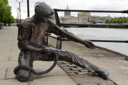 liffey: The Linesman statue at the bank of  Liffey  Dublin, IrelandArtist  Dony MacManus