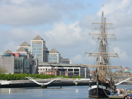 Mondern buildings and tall ship in Dublin - Ireland  photo
