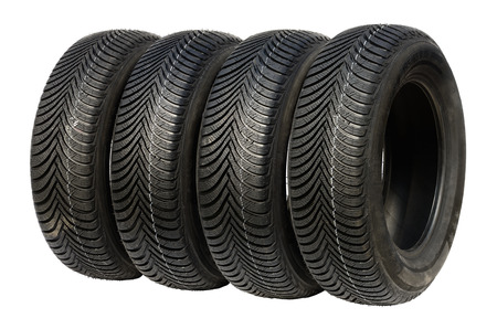 radial tire: Four winter tires for car isolated on white. Stock Photo