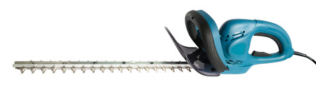 electric trimmer: New electric hedge trimmer isolated on white-