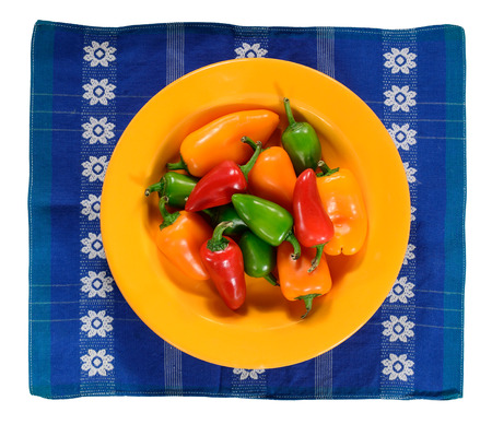 chilly: Green, yellow and red hot chilly peppers in plate, isolated on white.