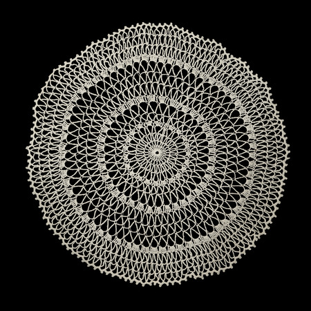 craft material: White handmade lace (round form), isolated on black. Stock Photo