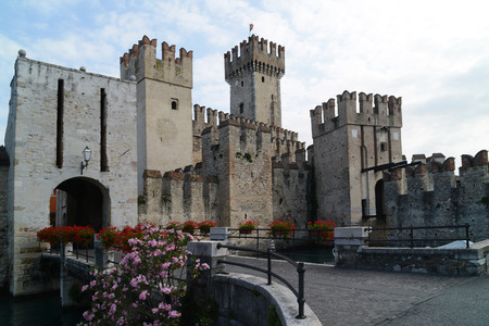 drawbridge: The medieval Scaliger Castle in Sirmione, a small town on the shores of Lake Garda, Italy.