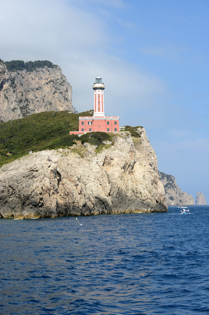 Punta Carena, a red lighthouse on the island of Capri (Italy).