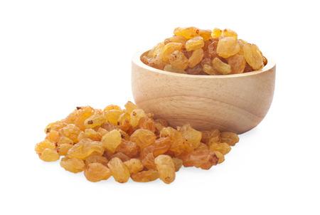 Pile of yellow raisins isolated Stock Photo