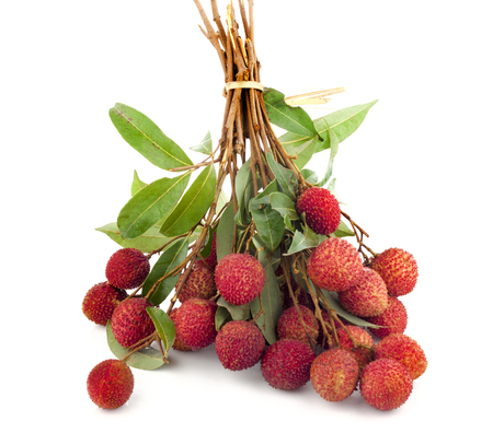 Lychee fruit, Fresh lychees with leaves isolated white background.
