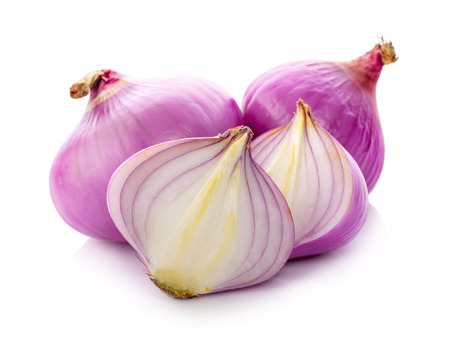 Slices of shallot onions for cooking on white background. Фото со стока