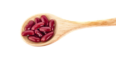 Red beans in wooden spoon isolated on white background