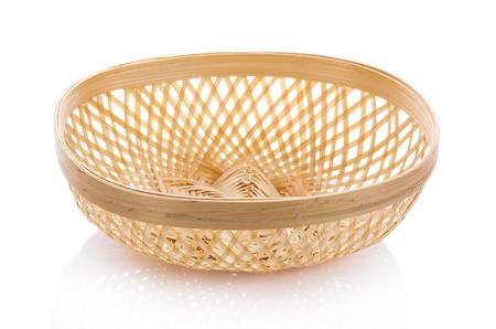 Basket wicker on isolated white background. Stock Photo