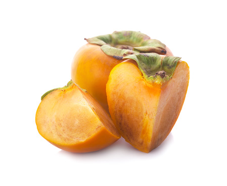 Tropical fruit persimmon. Kaki with leaves on white background.
