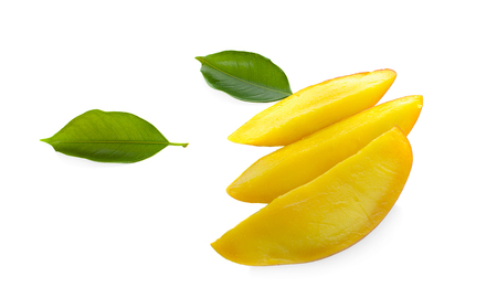 Mango fruit slices and mango leaves over white. File contains clipping paths 写真素材 - 125710482