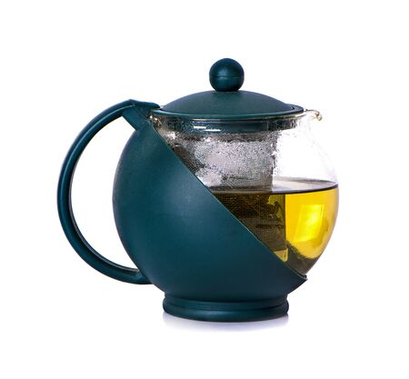 Teapot from transparent glass with a green handle