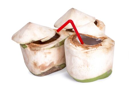Fresh green coconut with straw ready to drinking isolated on white background