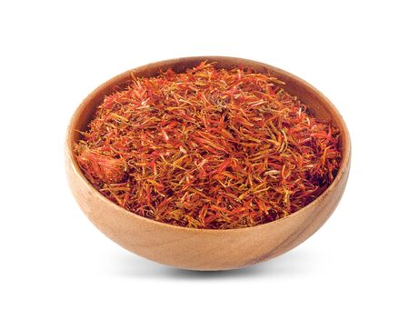 Safflower in a bowl on white background 写真素材