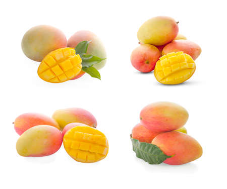 Mango fruit with mango cubes and slices. Isolated on a white background Banco de Imagens