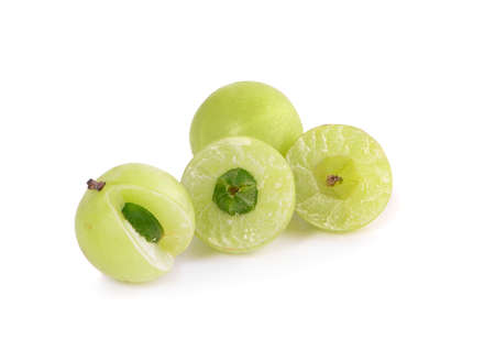 Indian gooseberry fruits or Amla ( phyllanthus emblica ) sliced isolated on white background Banco de Imagens