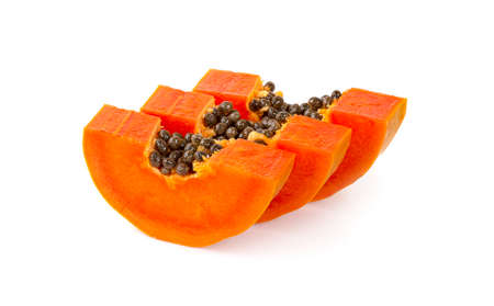 Ripe papaya slices on a white background