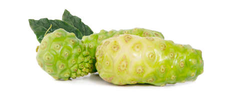 Noni or Morinda Citrifolia fruits with sliced and green leaf isolated on white background.