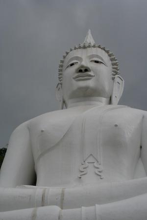grey  sky: White Buddha under grey sky Stock Photo