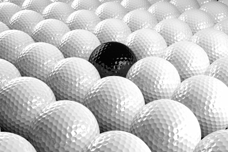 several: 3d White Golf balls & one black in the middle Stock Photo
