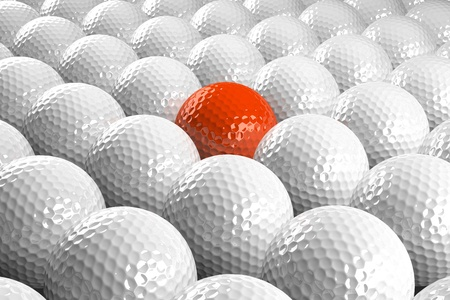des balles de Golf de White 3D & une orange au milieu Banque d'images