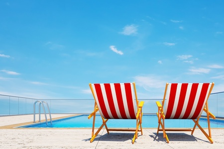 3d swimming pool with beach chairs Stock Photo - 12782183