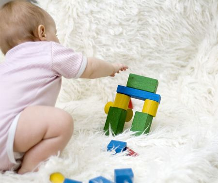 Child playing with a wooden constructor Stock Photo - 6061449
