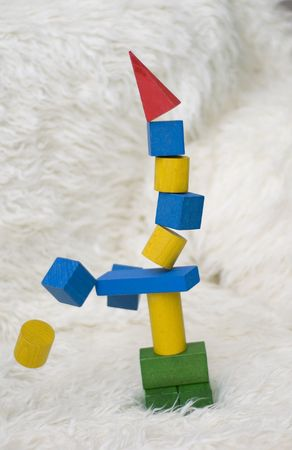 Fallen tower of colorful wooden blocks toy