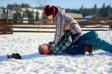 rollick: Young couple cheerfully flounders in snow