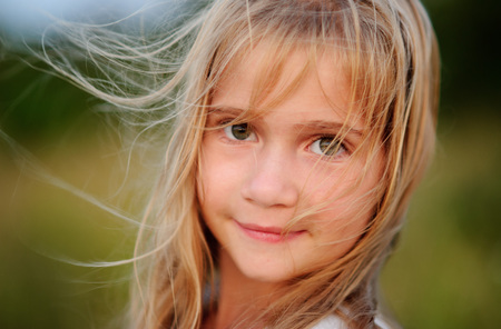 Portrait of the charming girl of 9-10 years.