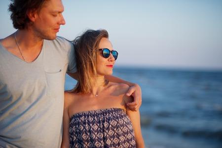 Happy couple of lovers on the seashore. Sea, sea breeze, gentle embraces. Stock Photo