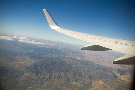 View from the airplane window. Beautiful scenery from an unexpected perspective. Terraneous objects seem to be toy.