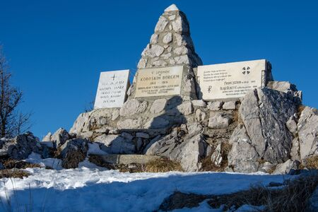 Uršlja gora, Slovenia - January 2, 2020; a monument to the soldiers fallen in World War I with shadow on it.