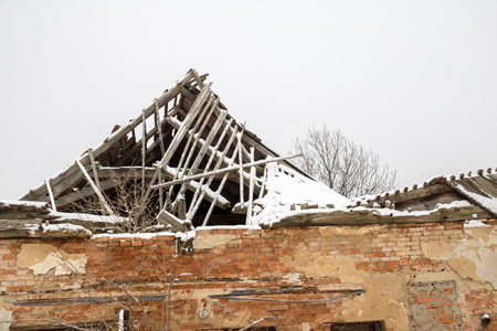 unsound: Ruined roof, in winter snow Stock Photo