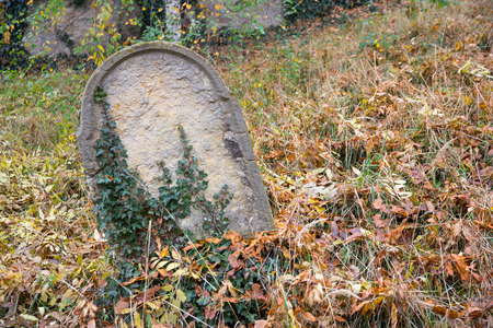 forgotten: Forgotten grave on ancient graveyard Stock Photo