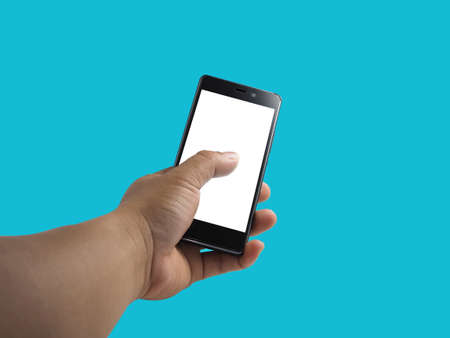 Human hand holding blank screen smart phone isolated on blue background. Stock fotó