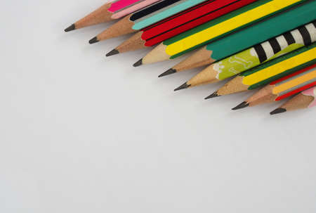 A pencil arranged in a row on a white background. Foto de archivo