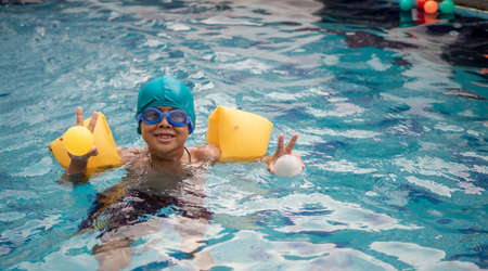 A boy swimming in the pool