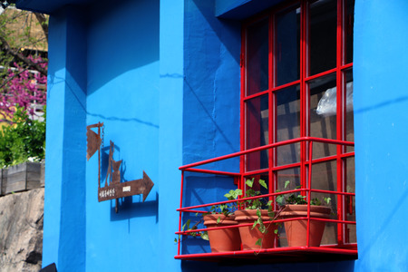red shutters: Red Window shutters, grey stone wall and, pollen,