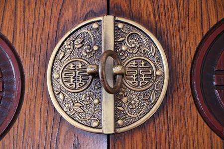 hook up: Close up of a wooden cupboard hook lock.