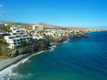 gran canaria: Panorama Image of the Beach in San Agustin  Gran Canaria. Wide sight on Coastline on a cloudless day Stock Photo