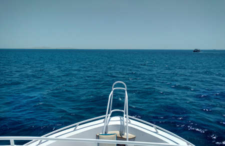 Beautiful view from the bow yacht towards the sea. Copy space. Snapshot of the front of the yacht in the summer.